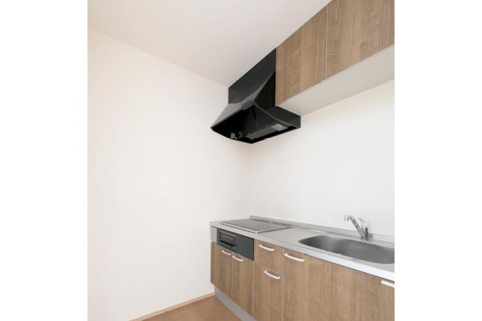 同居するご両親のため、キッチンを追加した2Fのリビングスペース。穏やかなテイストの内装が安心感を与え、機能性と快適さを両立しました。